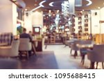 blur coffee shop or cafe... | Shutterstock . vector #1095688415