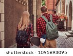 back view of a young hipster... | Shutterstock . vector #1095693095