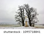 Small photo of winter landscape with calvary cross