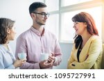colleagues chatting at office... | Shutterstock . vector #1095727991
