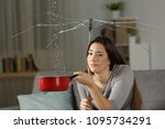 sad homeowner with water leaks... | Shutterstock . vector #1095734291