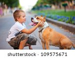 Stock photo happy young boy and his dog in summer street 109575671