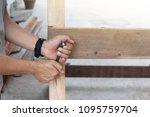 people carpenter manual use... | Shutterstock . vector #1095759704