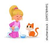 kid feeding her pet milk.... | Shutterstock .eps vector #1095789491