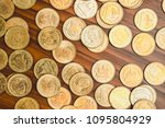stack of coin on wooden working ... | Shutterstock . vector #1095804929
