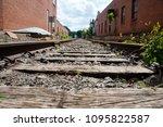 Brenham and Washington County, Texas USA 5/19/2018 Train tracks and warehouse buildings