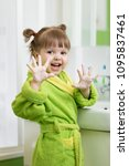 child in bathrobe washing hands ... | Shutterstock . vector #1095837461