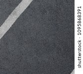 Small photo of New asphalt texture with white dashed line. Top view.