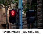 Small photo of Red man traffic light signal on the pole to stop