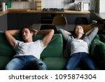 relaxed millennial couple... | Shutterstock . vector #1095874304