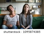 lazy millennial couple getting... | Shutterstock . vector #1095874385
