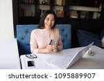 smiling asian manager posing on ... | Shutterstock . vector #1095889907