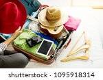 woman hand packing a luggage... | Shutterstock . vector #1095918314