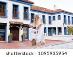 a young couple is walking along ... | Shutterstock . vector #1095935954