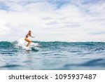 beautiful young surfer girl in... | Shutterstock . vector #1095937487