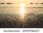 ripples in sand on beach at... | Shutterstock . vector #1095938327