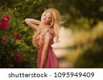 spring photo of a girl in roses | Shutterstock . vector #1095949409