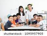cheerful male teacher...   Shutterstock . vector #1095957905