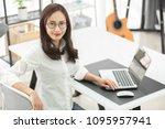 asian woman using laptop ...   Shutterstock . vector #1095957941