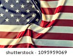 Small photo of American flag, symbol of the American state