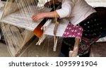 women weaving on a loom  real... | Shutterstock . vector #1095991904
