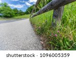 the road is in the mountains in ... | Shutterstock . vector #1096005359