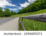 the road is in the mountains in ... | Shutterstock . vector #1096005371