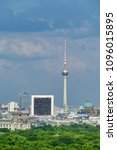Small photo of BERLIN, GERMANY, May 10, 2018: City view from the top of the Victory column Siegessaule, Berlin. Berlin with TV tower, the Brandenburg Gate, the Reichstag and the International Trade Center.