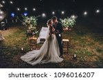 fashionable newlyweds stand at... | Shutterstock . vector #1096016207