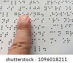 blind person reads braille...