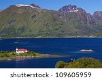 Picturesque church in fjord on Lofoten islands in Norway - stock photo