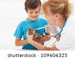 Little kitten at the veterinary getting medication - stock photo