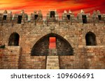 Jerusalem Old City - Damascus Gate (inside view) on the sunset background - stock photo