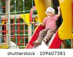 Two Year Child On Slide...