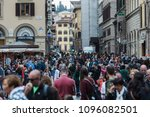 Small photo of Florence, Italy - May 5, 2018: A mass of people walking across the square in Florence, Italy