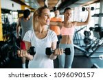 picture of two fitness women in ... | Shutterstock . vector #1096090157