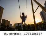 child swinging on swing in... | Shutterstock . vector #1096106987