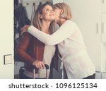 an adult daughter leaves her... | Shutterstock . vector #1096125134