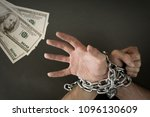 hands chained together reaches... | Shutterstock . vector #1096130609