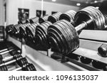 heavy dumbbells lying in the... | Shutterstock . vector #1096135037