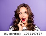 Small photo of Portrait of funny dreamy girl with vivid bright pomade find idea solution decision looking up with open mouth guessing answer isolated on violet background