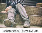 Small photo of Holey shoes as a symbol of a childhood in social disadvantage