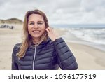 attractive woman on a windswept ...   Shutterstock . vector #1096177919