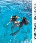 Small photo of Two divers are trained in the sea. Scuba diver before diving. Diving lesson in open water.