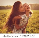 happy loving mother hugging her ... | Shutterstock . vector #1096213751