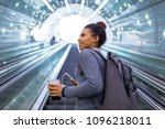 young woman on subway escalator | Shutterstock . vector #1096218011