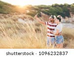 young couple taking selfie at... | Shutterstock . vector #1096232837