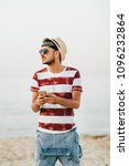 young man at the beach using... | Shutterstock . vector #1096232864