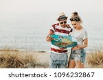 young couple at the beach using ... | Shutterstock . vector #1096232867