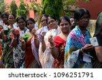 indian women stand in queue... | Shutterstock . vector #1096251791
